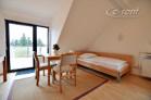 Modern möbliertes Dachstudio mit großer Terrasse in Köln-Junkersdorf